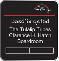 Image of the sign displaying Board Room in the Lushootseed language